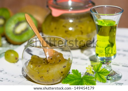 Kiwi and gooseberry confiture with liqueur - stock photo