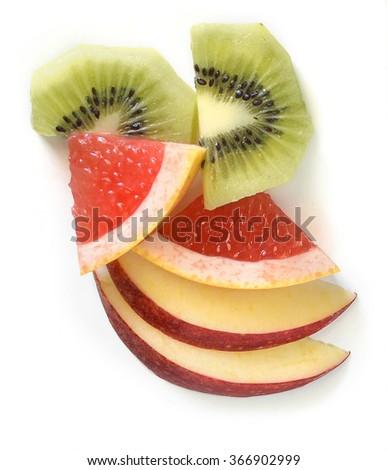 kiwi, apples and grapefruit slices on a white background - stock photo