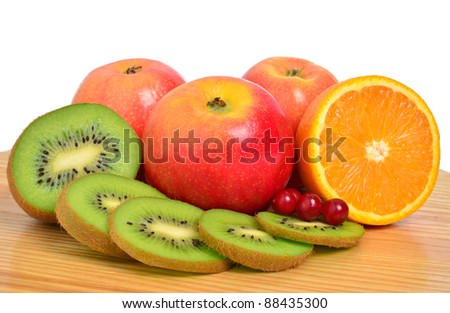 Kiwi, apples, orange and cranberry isolated on white background
