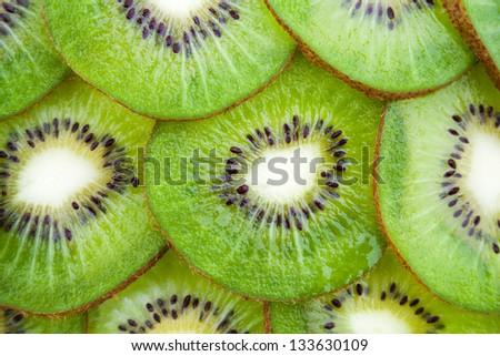 Kiwi cut by segments - stock photo