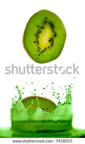 kiwi falling in juice. Isolation. - stock photo