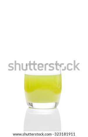 Kiwi fruit juice in a glass isolated on white background, clipping path included