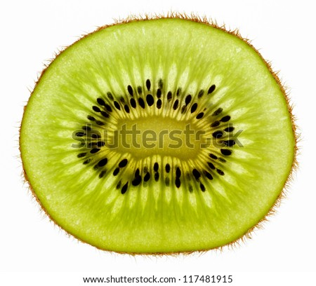 Kiwi fruit portion against light table - stock photo