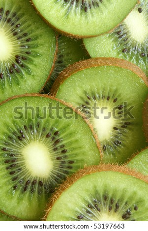 Kiwi fruit slices, for backgrounds or textures - stock photo