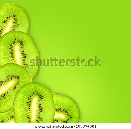 kiwi fruit slices on a green background - stock photo