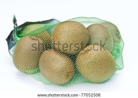 Kiwi fruits in a net bag on a white background - stock photo