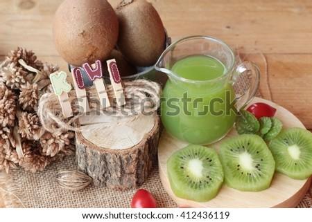 Kiwi juice and fresh kiwi  - stock photo