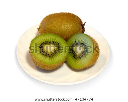 Kiwi on a plate. One fetus was cut into pieces. - stock photo