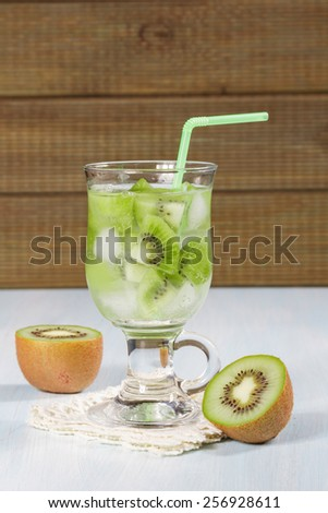 Kiwi refreshing drink on a wooden table. - stock photo