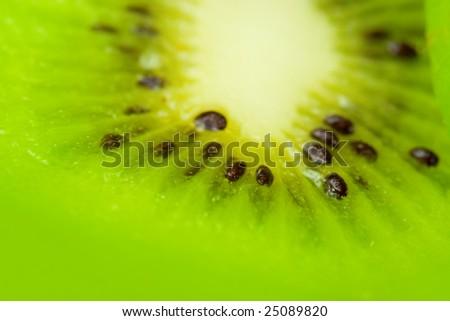 Kiwi slice, close up photo with shallow DOF. Nice fruit abstract background - stock photo