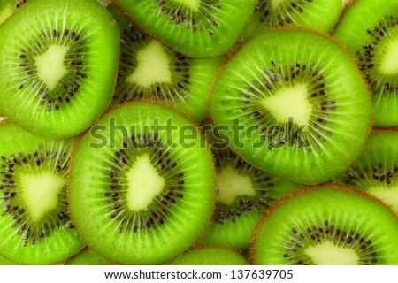 Kiwi slices as background - stock photo