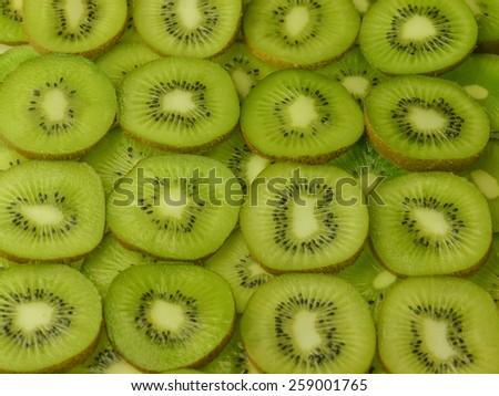 kiwi slices background - stock photo