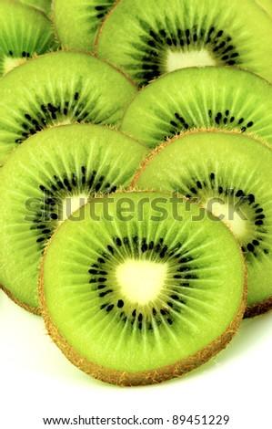 Kiwifruit slices on white background - stock photo