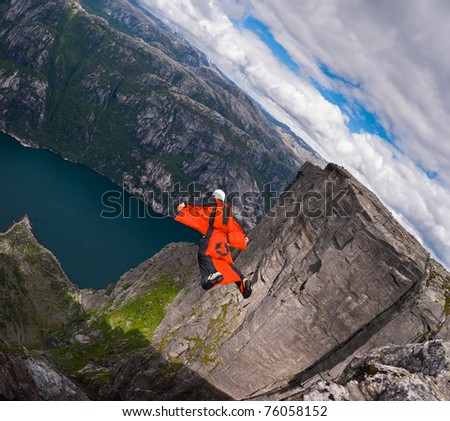 KJERAG, NORWAY - AUGUST 21: a  B.A.S.E. jumper in wingsuit jumps off a cliff. August 21, 2010 in Kjerag, Norway. Wingsuit cliff jumping is an advanced discipline, it makes human flight possible.