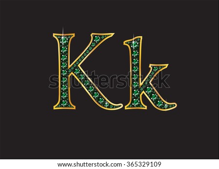 Kk in stunning emerald precious round jewels set into a 2-level gold gradient channel setting, isolated on black. High-resolution raster JPEG version.  - stock photo