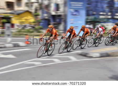 KL, MALAYSIA - 1 FEBRUARY: Cyclists from various teams at the le Tour de Langkawi race, Stage 10 from Shah Alam to KL on February 1 2011 in Kuala Lumpur, Malaysia - stock photo