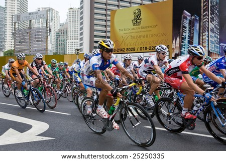 KL, MALAYSIA - 15 February: Cyclists on Jalan Ampang at the le Tour de Langkawi race, Stage 7, KL Criterium.in Kuala Lumpur Malaysia 15 February 2009
