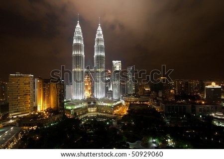 KL Petronas Towers at night - stock photo