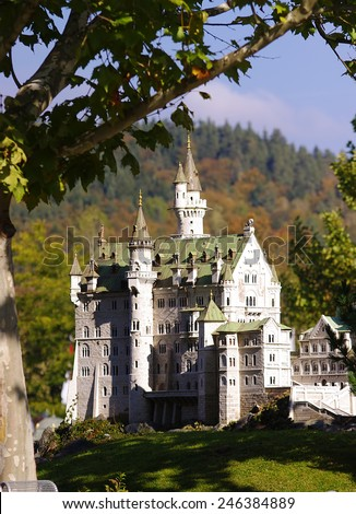 KLAGENFURT, AUSTRIA - OCTOBER 16, 2011: Neuschwanstein castle is a 19-th century Romanesque Revival palace in Germany. Miniature photo in Minimundus park, Klagenfurt, Austria on October 16, 2011.  - stock photo