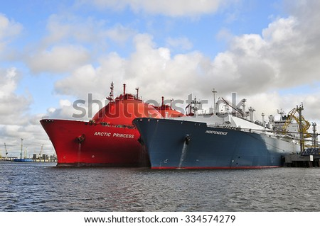 KLAIPEDA,LITHUANIA- JULY 20:The liquefied-natural-g as (LNG) ship Independence and LNG Tanker ARCTIC PRINCESS (registered in Norway) in Klaipeda port on July 20,2015 in Klaipeda,Lithuania.