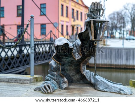 KLAIPEDA, LITHUANIA - 05 MARCH 2016: The Black Ghost bronzed sculpture (designed by Svajunas Jurkus and Sergejus Plotnikovas). Danes river quay. Klaipeda Old Town residential district. Lithuania