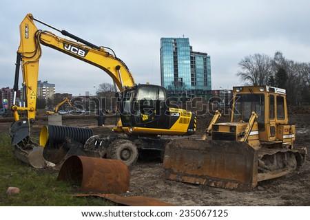 KLAIPEDA,LITHUANIA-NOV 24:excavator and tractoron road repair on November 24,2014 in Klaipeda,Lithuania. - stock photo