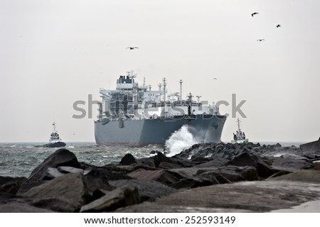 KLAIPEDA, LITHUANIA-OCT 27: The liquefied-natural-gas (LNG) ship Independence in Klaipeda port in very cloudy and foggy day on October 27,2014 in Klaipeda, Lithuania.
