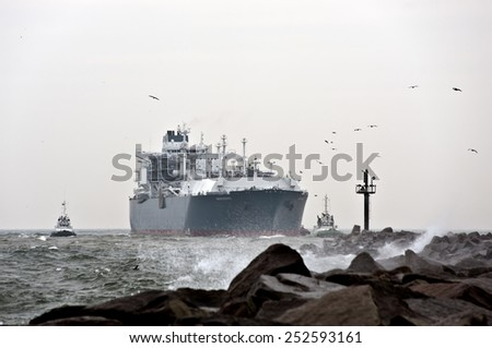 KLAIPEDA, LITHUANIA - OCT 27: The liquefied-natural-gas (LNG) ship Independence in Klaipeda port in very cloudy and foggy day on October 27,2014 in Klaipeda, Lithuania.