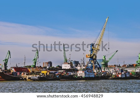 Klaipeda, Lithuania. Ships and cranes at central industrial wharf of city port. Taken on 2016/06/18