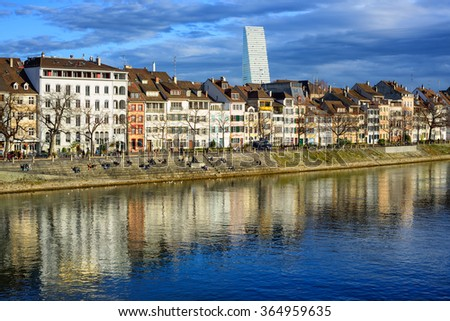 Klein Basel district on Rhine river shore with Roche Tower in background, Basel, Switzerland - stock photo