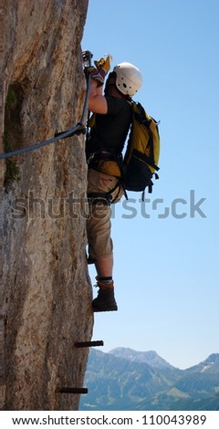 klettersteig - extreme sport in austria - stock photo