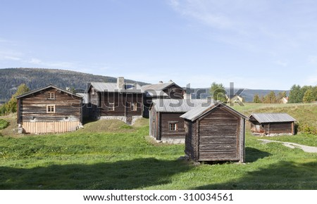 KLOVSJO, SWEDEN ON SEPTEMBER 09. View of old wooden buildings at a Public park, Folk museum on September 09, 2013 in Klovsjo, Sweden. Collection from the neighborhood.