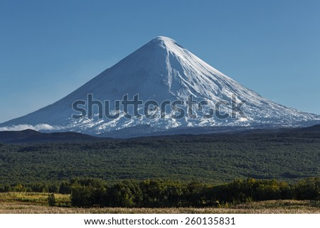 Klyuchevskaya Sopka (Kliuchevskoi Volcano) - highest mountain on Kamchatka Peninsula and highest active volcano of Europe and Asia. - stock photo