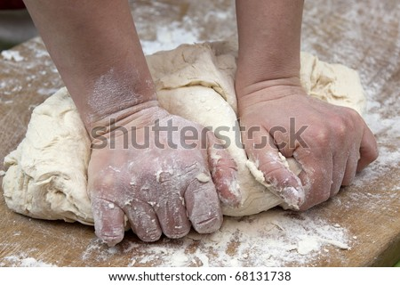 knead the dough by hand - stock photo
