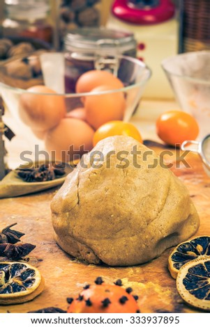 Kneaded dough into iced gingerbread. Kitchen table with ingredients - stock photo