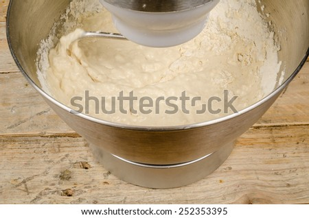 Kneading dough with a domestic food processor - stock photo