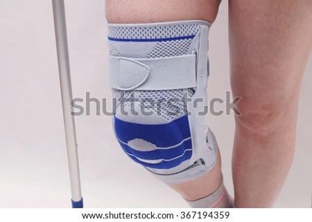 Knee brace on a woman's leg - stock photo