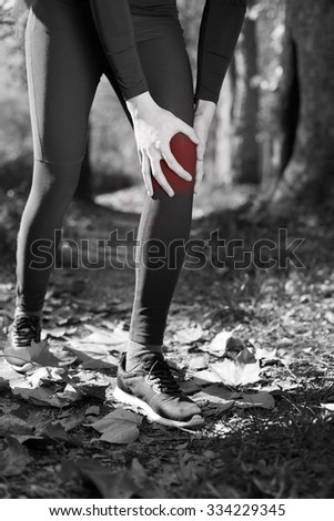 Knee Injury - sports running knee injuries on woman. Male runner with pain from sprain knee. Close up of legs, muscle and knee outdoors. - stock photo