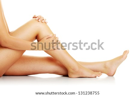 Knee Injury. Woman holding on sore knee. - stock photo