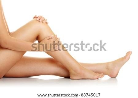 Knee Injury. Woman holding on sore knee. - stock photo
