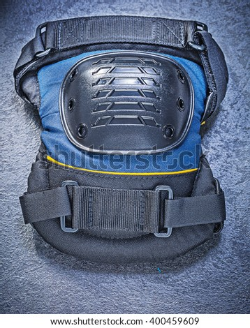 Knee pads on black background construction concept. - stock photo