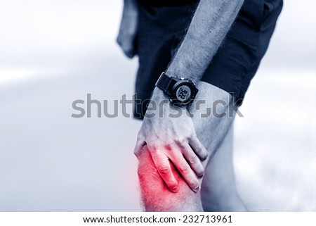 Knee pain, runner leg and muscle pain running and training outdoors, sport and jogging physical injuries when working out. Male athlete holding painful leg. - stock photo
