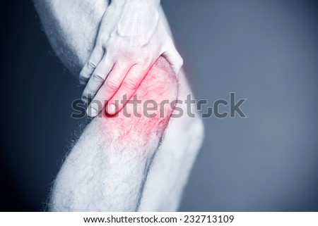 Knee pain, runner leg and muscle pain running and training, sport and jogging physical injuries when working out. Male athlete holding painful leg. - stock photo
