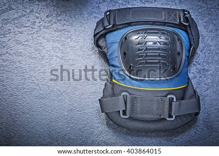 Knee protectors on black background construction concept. - stock photo