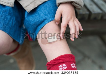 Knee that put a bandage - stock photo