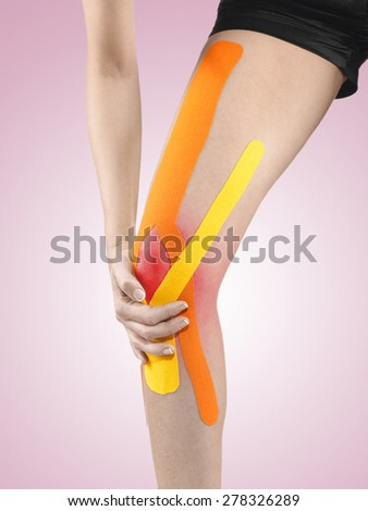 Knee treated with tex tape therapy. - stock photo