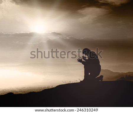 Kneeling. Ask, Sad, Alone, Man, Pray, God, Live, Mercy, Church, Trust, Sin, Fast, Black, Muslim, Islam, Person, Beg, Peace, People, Lonely, Humble, Refugee, Answers, Wellness, Abstract, Help, Crying. - stock photo