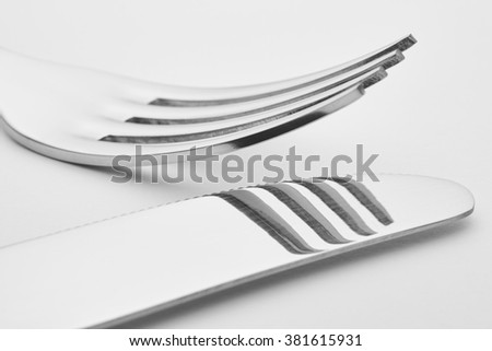 Knife and fork detail over a white background. Cutlery. Horizontal