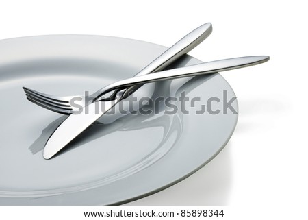 Knife and fork on a plate.