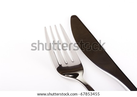 Knife and fork on a white background - tableware. - stock photo